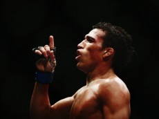 AUCKLAND, NEW ZEALAND - JUNE 28:  Charles Oliveira of Brazil celebrates after winning the UFC Featherweight bout between Charles Oliveira of Brazil and Hatsu Hioki of Japan on June 28, 2014 in Auckland, New Zealand.  (Photo by Hannah Peters/Getty Images)