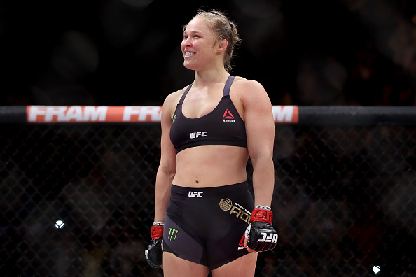 RIO DE JANEIRO, BRAZIL - AUGUST 01:  Ronda Rousey of the United States defeats Bethe Correia of Brazil in their bantamweight title fight during the UFC 190 Rousey v Correia at HSBC Arena on August 1, 2015 in Rio de Janeiro, Brazil.  (Photo by Matthew Stockman/Getty Images)
