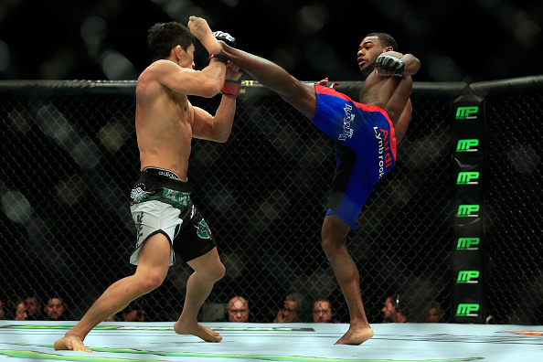NEWARK, NJ - APRIL 18:  : Takeya Mizugaki of Japan (white and black shorts) and Aljamain Sterling (blue shorts) fight in their bantamweight bout during the UFC Fight Night event at Prudential Center on April 18, 2015 in Newark, New Jersey.  (Photo by Alex Trautwig/Getty Images)