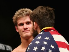 NEWARK, NJ - JANUARY 30:  (L-R) Sage Northcutt of the United States congratulates Bryan Barberena of the United States on Barberena's win by submission in the second round of their welterweight bout during the UFC Fight Night event at the Prudential Center on January 30, 2016 in Newark, New Jersey.  (Photo by Elsa/Getty Images)