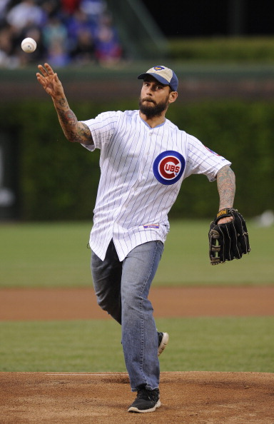 CHICAGO, IL - MAY 08: WWE Champion CM Punk throws out the first pitch before the Chicago Cubs versus the Atlanta Braves game on May 8, 2012 at Wrigley Field in Chicago, Illinois.  (Photo by David Banks/Getty Images)