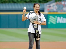 CHICAGO, IL - JULY 21: UFC women straweight champion Joanna Jedrzejczyk poses for a photo before throwing out a ceremonial first pitch before the game between the Chicago White Sox and the Detroit Tigers at U.S. Cellular Field on July 21, 2016 in Chicago, Illinois. (Photo by Jon Durr/Getty Images)