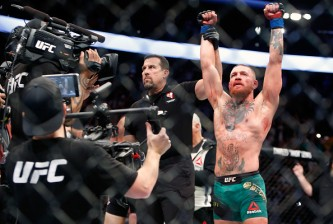 LAS VEGAS, NV - AUGUST 20:  Conor McGregor (R) celebrates after defeating Nate Diaz by majority decision in a welterweight rematch at the UFC 202 event at T-Mobile Arena on August 20, 2016 in Las Vegas, Nevada.  (Photo by Steve Marcus/Getty Images)