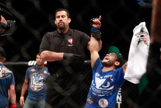 LAS VEGAS, NV - JANUARY 31:  John Lineker celebrates his victory over Ian McCall after their flyweight bout during UFC 183 at the MGM Grand Garden Arena on January 31, 2015 in Las Vegas, Nevada.  (Photo by Steve Marcus/Getty Images)