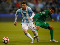 SEATTLE, WA - JUNE 14:  Lionel Messi #10 of Argentina dribbles against Danny Bejarano #4 of Bolivia during the 2016 Copa America Centenario Group D match at CenturyLink Field on June 14, 2016 in Seattle, Washington.  (Photo by Otto Greule Jr/Getty Images)