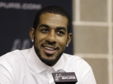 LaMarcus Aldridge answers questions during a news conference at the team's practice facility as he is formally introduced after he signed with the San Antonio Spurs NBA basketball team, Friday, July 10, 2015, in San Antonio. (AP Photo/Eric Gay)
