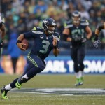 SEATTLE, WA - NOVEMBER 02:  Quarterback Russell Wilson #3 of the Seattle Seahawks rushes against the Oakland Raiders at CenturyLink Field on November 2, 2014 in Seattle, Washington.  (Photo by Otto Greule Jr/Getty Images)