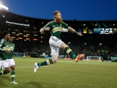 Portland Timbers defender Nat Borchers (7) celebrates his goal against FC Dallas during an MLS soccer game Saturday, April 4, 2015, in Portland, Ore. (AP Photo/The Oregonian, Thomas Boyd)