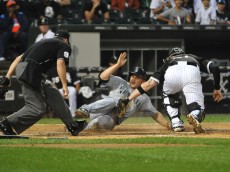 CHICAGO, IL - AUGUST 29: Kyle Seager #15 of the Seattle Mariners is tagged out by Tyler Flowers #21 of the Chicago White Sox during the third inning on August 29, 2015 at U.S. Cellular Field in Chicago, Illinois.  (Photo by David Banks/Getty Images)