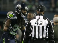 Seahawks cornerback Richard Sherman argues a pass interference call in the second quarter as the Seattle Seahawks take on the Arizona Cardinals Sunday November 15, 2015 at CenturyLink Field in Seattle.