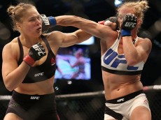 in their UFC women's bantamweight championship bout during the UFC 193 event at Etihad Stadium on November 15, 2015 in Melbourne, Australia.