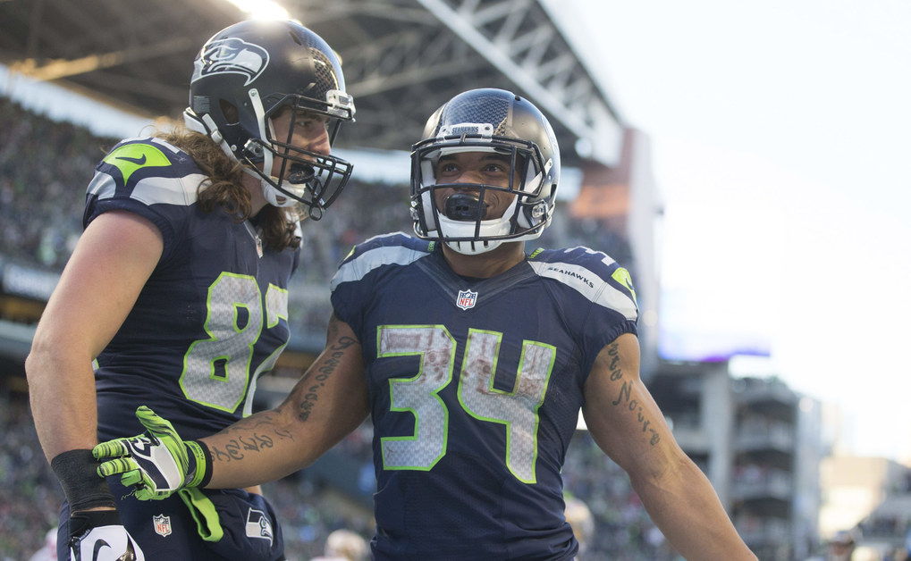 Seahawks tight end Luke Willson celebrates a touchdown with Seahawks running back Thomas Rawls in the third quarter at CenturyLink Field Sunday, Nov. 22, 2015.  (Mike Siegel / The Seattle Times)