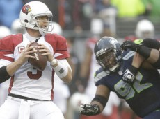 Arizona Cardinals quarterback Carson Palmer (3) looks to pass against the Seattle Seahawks in the first half of an NFL football game, Sunday, Dec. 22, 2013, in Seattle. (AP Photo/Elaine Thompson)