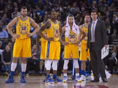 November 17, 2015; Oakland, CA, USA; Golden State Warriors interim head coach Luke Walton (far right) stands with his team during the fourth quarter against the Toronto Raptors at Oracle Arena. The Warriors defeated the Raptors 115-110. Mandatory Credit: Kyle Terada-USA TODAY Sports