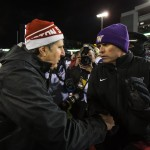 112914 - PULLMAN, WA - Coaches Mike Leach, left, and Chris Petersen shake hands after the Huskies defeated the Cougars 31-13 to win the 2014 edition of the Apple Cup game. (UWFootball30)