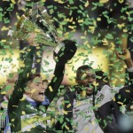 Portland Timbers forward Lucas Melano, left, of Argentina,and forward Fanendo Adi, of Nigeria, raise the trophy after defeating the Columbus Crew 2-1 in the MLS Cup championship soccer game Sunday, Dec. 6, 2015, in Columbus, Ohio. (AP Photo/Jay LaPrete)