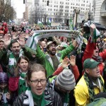 Fans cheer during the MLS champion Portland Timbers parade through Portland, Ore., Tuesday, Dec. 8, 2015.  The Timbers defeated the Columbus Crew 2-1 Sunday in the MLS Cup soccer final. (AP Photo/Steve Dipaola)