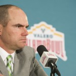 Mark Helfrich listens to a questions. Coaches Mark Helfrich and Garry Patterson address the media in the head coaches press conference on Jan. 1, 2016 . (Cole Elsasser/Emerald)