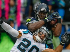 SEATTLE, WA - OCTOBER 18:  Wide receiver Ricardo Lockette #83 of the Seattle Seahawks makes a catch for a touchdown against defensive back Kurt Coleman #20 of the Carolina Panthers in the third quarter at CenturyLink Field on October 18, 2015 in Seattle, Washington. The Panthers defeated the Seahawks 27-23.  (Photo by Otto Greule Jr/Getty Images)