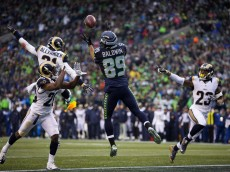Seahawks wide receiver Doug Baldwin pulls in a pass from Seahawks quarterback Russell Wilson for a touchdown in the third quarter at CenturyLink Field, Sunday, Dec. 27, 2015.  (Dean Rutz / The Seattle Times)