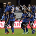 San Jose Earthquakes forward Quincy Amarikwa (25) is mobbed by teammates after scoring against the Portland Timbers during the first half of an MLS soccer match Sunday, March 13, 2016, in San Jose, Calif. (AP Photo/Marcio Jose Sanchez)