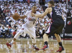 Portland Trail Blazers guard C.J. McCollum, left, dribbles past Los Angeles Clippers forward Blake Griffin, right, during the second half of Game 3 of an NBA basketball first-round playoff series Saturday, April 23, 2016, in Portland, Ore. Portland won 96-88. (AP Photo/Craig Mitchelldyer)