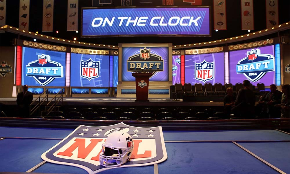 May 8, 2014; New York, NY, USA; A general view of a helmet, NFL shield, stage, and podium before the start of the 2014 NFL Draft at Radio City Music Hall. Mandatory Credit: Adam Hunger-USA TODAY Sports