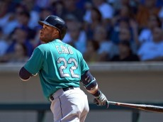 Mar 27, 2016; Mesa, AZ, USA; Seattle Mariners second baseman Robinson Cano (22) hits a three run home run during the second inning against the Chicago Cubs at Sloan Park. Mandatory Credit: Jake Roth-USA TODAY Sports