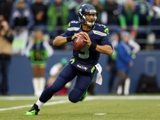 SEATTLE, WA - JANUARY 19:  Quarterback Russell Wilson #3 of the Seattle Seahawks drops back against the San Francisco 49ers during the 2014 NFC Championship at CenturyLink Field on January 19, 2014 in Seattle, Washington.  (Photo by Ronald Martinez/Getty Images)