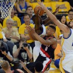 The Golden State Warriors' Draymond Green (23) and Andrew Bogut (12) block a shot by the Portland Trailblazers' Damian Lillard (0) in the first quarter of Game 1 of the second round of the NBA Western Conference playoffs at Oracle Arena in Oakland, Calif., on Sunday, May 1, 2016. (Dan Honda/Bay Area News Group)