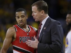 Portland Trail Blazers coach Terry Stotts, right, talks to guard C.J. McCollum during the first half in Game 5 of the team's second-round NBA basketball playoff series against the Golden State Warriors on Wednesday, May 11, 2016, in Oakland, Calif. (AP Photo/Marcio Jose Sanchez)