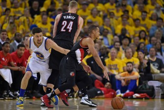 Portland Trail Blazers' C.J. McCollum (3) drives past teammate Portland Trail Blazers' Mason Plumlee (24) as Golden State Warriors' Klay Thompson (11) chases him in the first quarter of Game 2 during the second round of the NBA Western Conference playoffs at Oracle Arena in Oakland, Calif., on Tuesday, May 3, 2016. (Jose Carlos Fajardo/Bay Area News Group)