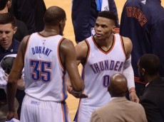 May 24, 2016; Oklahoma City, OK, USA; Oklahoma City Thunder guard Russell Westbrook (0) and forward Kevin Durant (35) react after leaving the court during action against the Golden State Warriors during the fourth quarter in game four of the Western conference finals of the NBA Playoffs at Chesapeake Energy Arena. Mandatory Credit: Mark D. Smith-USA TODAY Sports