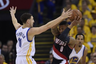 Golden State Warriors' Klay Thompson (11) guards Portland Trail Blazers' Damian Lillard (0) in the first quarter of Game 2 during the second round of the NBA Western Conference playoffs at Oracle Arena in Oakland, Calif., on Tuesday, May 3, 2016. (Jose Carlos Fajardo/Bay Area News Group)
