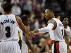 Oct 18, 2015; Portland, OR, USA;  Portland Trail Blazers guard Damian Lillard (0) celebrates with C.J. McCollum (3) after making a free-throw to cut the Utah Jazz lead to one point during the fourth quarter of the NBA preseason game at Moda Center at the Rose Quarter. The Blazers won 116-111. Mandatory Credit: Godofredo Vasquez-USA TODAY Sports
