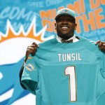 Apr 28, 2016; Chicago, IL, USA; Laremy Tunsil (Mississippi) is selected by the Miami Dolphins as the number thirteen overall pick in the first round of the 2016 NFL Draft at Auditorium Theatre. Mandatory Credit: Kamil Krzaczynski-USA TODAY Sports