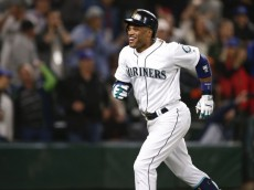 May 25, 2016; Seattle, WA, USA; Seattle Mariners second baseman Robinson Cano (22) celebrates after hitting a solo homer against the Oakland Athletics during the eighth inning at Safeco Field. Seattle defeated Oakland 13-3. Mandatory Credit: Joe Nicholson-USA TODAY Sports