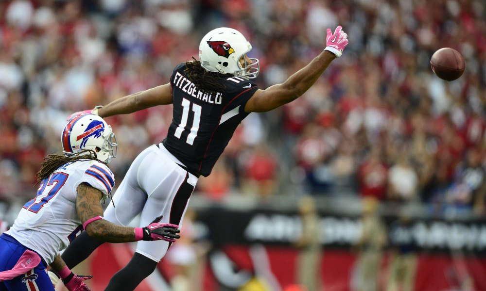 Oct. 14, 2012; Glendale, AZ, USA; Arizona Cardinals wide receiver (11) Larry Fitzgerald is unable to come up with an overthrown pass against the Buffalo Bills at University of Phoenix Stadium. Mandatory Credit: Mark J. Rebilas-USA TODAY Sports