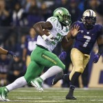 Oct 17, 2015; Seattle, WA, USA; Oregon Ducks running back Royce Freeman (21) rushes against the Washington Huskies during the fourth quarter at Husky Stadium. Mandatory Credit: Jennifer Buchanan-USA TODAY Sports