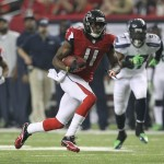 Jan 13, 2013; Atlanta, GA, USA; Atlanta Falcons wide receiver Julio Jones (11) carries the ball after a catch against the Seattle Seahawks in the third quarter of the NFC divisional playoff game at the Georgia Dome. Mandatory Credit: Daniel Shirey-USA TODAY Sports