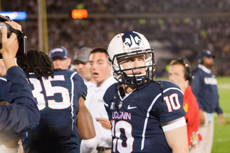 UConn QB Chandler Whitmer (10) looks at the video board after throwing a 39 yard TD pass to Geremy Davis in the 2nd quarter at Rentschler Field on September 21, 2013. The play was ruled incomplete after a review