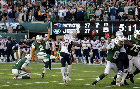 Kicker Nick Folk #2 of the New York Jets hits the game winning field goal in overtime against the New England Patriots at MetLife Stadium on October 20, 2013 in East Rutherford, New Jersey.