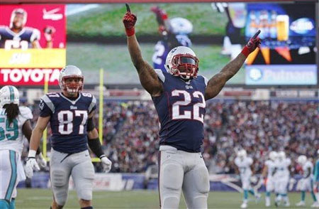 New England Patriots running back Stevan Ridley (22) celebrates his touchdown against the Miami Dolphins in the fourth quarter of an NFL football game Sunday, Oct. 27, 2013, in Foxborough, Mass. At left is Patriots tight end Rob Gronkowski.