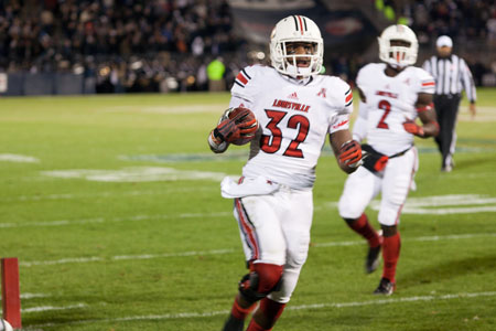 Louisville RB Senorise Perry scores on a five-yard run in the second quarter against the UConn Huskies on Friday night at Rentschler Field.