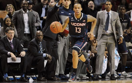 Shabazz Napier #13 of the Connecticut Huskies carries the ball upcourt during the second half against the Maryland Terrapins at Barclays Center on November 8, 2013 in the Brooklyn borough of New York City.