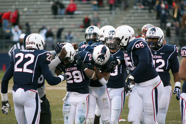 UConn CB Taylor Mack (29) gets congratulated by members of the defense after his interception late in the 4th quarter against the Rutgers Scarlet Knights at Rentschler Field in East Hartford, CT on November 30, 2013.