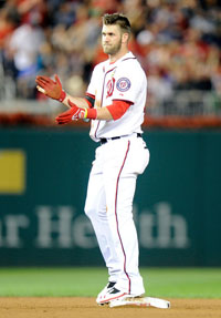 Bryce Harper #34 of the Washington Nationals stands on second base after hitting a double in the sixth inning against the Miami Marlins at Nationals Park on September 20, 2013 in Washington, DC.
