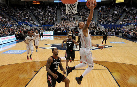 Connecticut guard Shabazz Napier glides in for two of his game high 18 points against Sean Kilpatrick and the Cincinnati Bearcats.