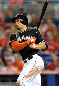 Giancarlo Stanton #27 of the Miami Marlins connects for a double during the seventh inning against the St. Louis Cardinals at Marlins Park on June 14, 2013 in Miami, Florida.