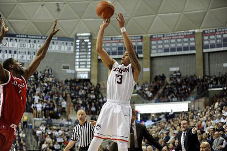Connecticut Huskies guard Shabazz Napier (13) takes a shot over Rutgers Scarlet Knights' Malick Kone during the first half at Gampel Pavilion in Storrs, Conn., on Wednesday, March 5, 2014.
